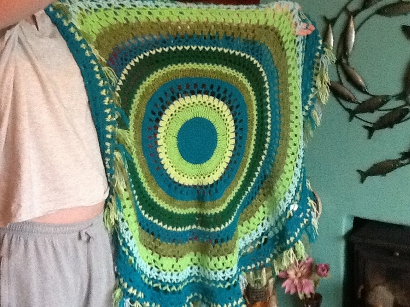 green-and-turquoise-fringed-picnic-blanket